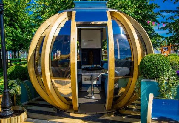 garden pods - photo of big garden pod with glass walls.