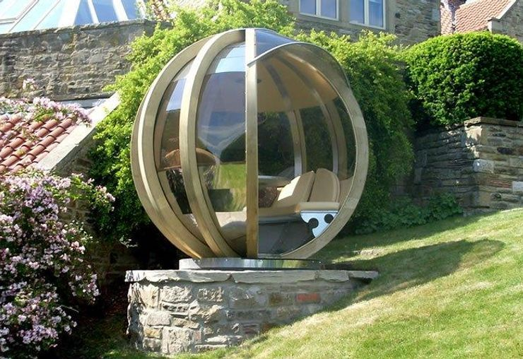 garden pods - photo of a rotating lounge garden pod with glass walls.